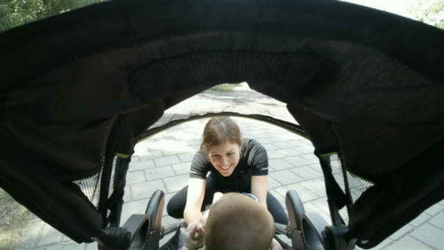 POV Millennial Mother Playing With Baby Boy Inside Stroller