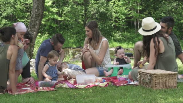 millennial parents outdoor week end - hamper stock videos & royalty-free footage