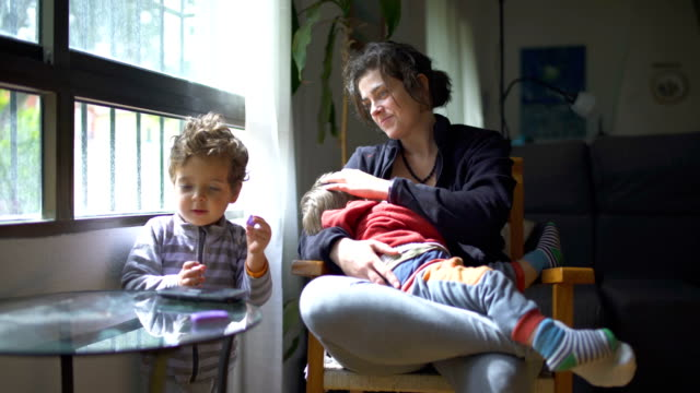 millennial parents - breastfeeding stock videos & royalty-free footage