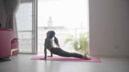 Millennial-aged women practicing yoga