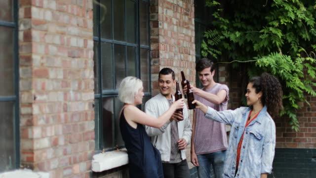 Millennials drinking beer in pub garden