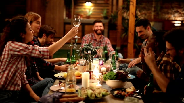 millennials enjoying dinner - pranzare video stock e b–roll