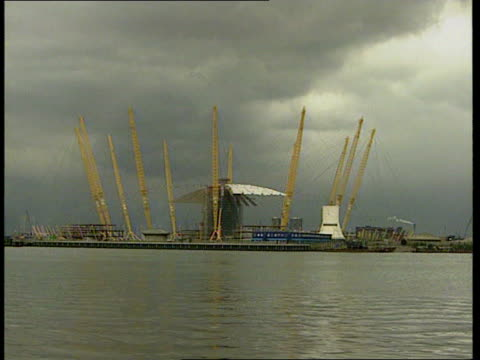 millennium bank holidays; itn england: london: greenwich gv millennium dome site seen across river zoom in - the o2 england stock videos & royalty-free footage