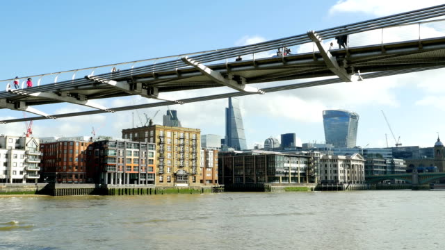 millennium bridge and city of london (4k/uhd to hd) - london millennium footbridge stock videos and b-roll footage