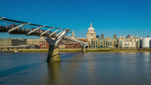 millennium bridge and st paul's cathedral in london timelapse. - london millennium footbridge stock videos and b-roll footage