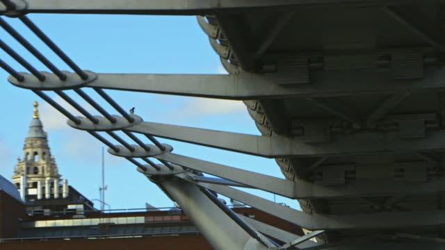 SLO MO POV MS Millennium Bridge and St Paul's Cathedral / London, England, United Kingdom