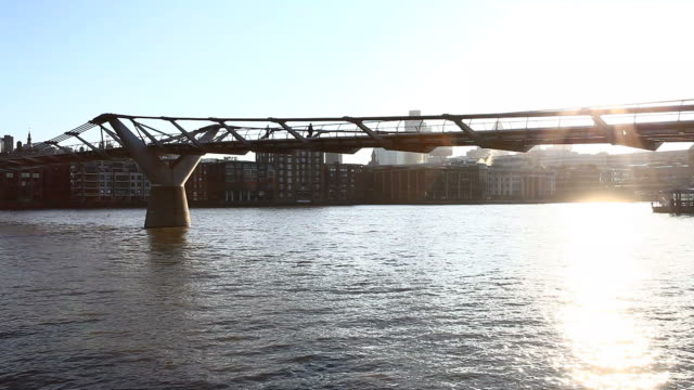 millennium bridge in london at morning, hd video - clear sky stock videos & royalty-free footage