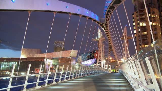 t/l, ms, millennium bridge leading to lowry centre at salford quays illuminated at dusk, manchester, england - stationary process plate stock videos and b-roll footage