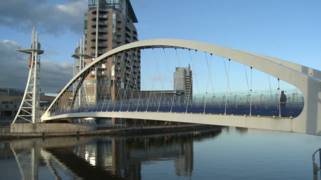 ws, pan, millennium bridge leading to lowry centre at salford quays, manchester, england - steel stock videos & royalty-free footage