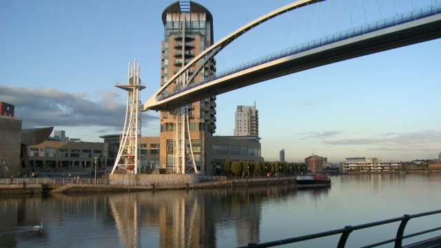 t/l, ws, millennium bridge moving up and down, ship passing under bridge, manchester, england - salford quays stock videos & royalty-free footage