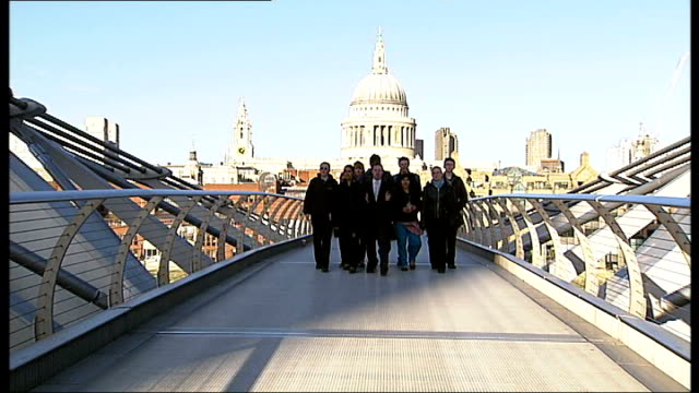 new study at university of bristol reveals people walking caused bridge to sway river thames water rocking with millennium footbridge in the... - dondolarsi video stock e b–roll