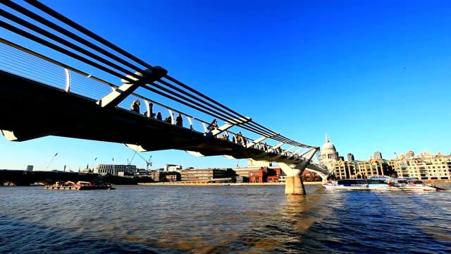 millennium bridge panning to st. paul's cathedral - london millennium footbridge stock videos and b-roll footage