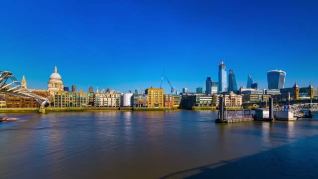 millennium bridge with st paul's cathedral and skyscrapers in the city of london timelapse. - building exterior stock videos & royalty-free footage