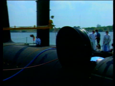 Millennium bug trident missiles fear LIB Trident submarine moored in docks with workers around Crew of submarine at controls