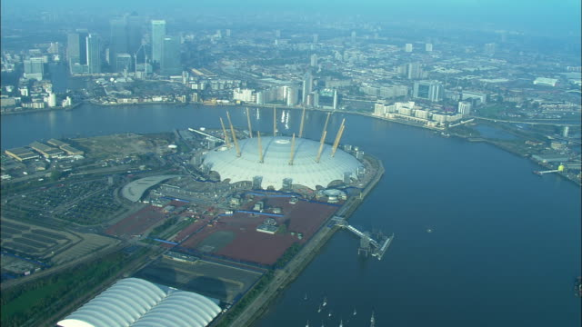 aerial, millennium dome and thames river, london, england - the o2 england stock videos & royalty-free footage
