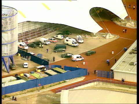 attempted robbery aftermath bc5l u lib england london greenwich view of police vehicles along outside millennium dome at incident area ms police... - the o2 england stock videos & royalty-free footage