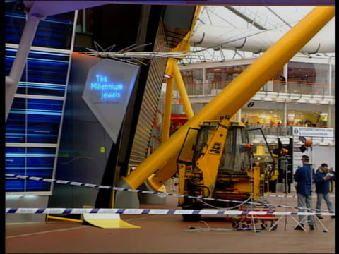 man arrested lib england london greenwich cms 'the millennium jewels' sign pull out jcb digger behind police cordon millennium dome visitors along... - the o2 england stock videos & royalty-free footage