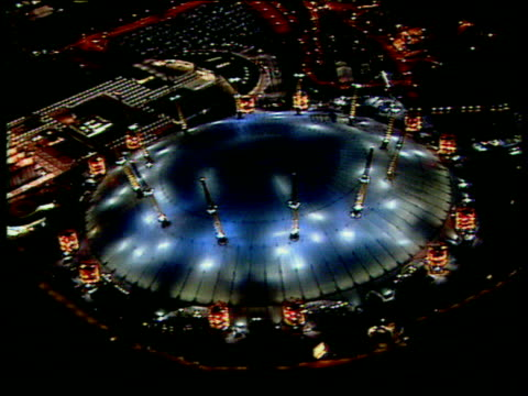 profits row; c5f: faye barker lib england: london: greenwich: ext at night air view millennium dome illuminated by coloured spotlights at opening... - the o2 england stock videos & royalty-free footage