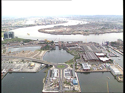 Short attack LIB Greenwich TGV Site of exhibition seen from Canary Wharf Canary Wharf Tower seen from site Sign `Warning Contaminated Ground Keep...