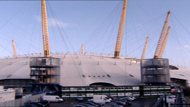 millennium dome to re-open as o2 centre; england: london: greenwich: ext exterior of millennium dome fade to... int renovation work underway inside... - the o2 england stock videos & royalty-free footage