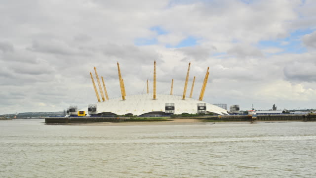 T/L Millennium Dome with stormy clouds, London, England