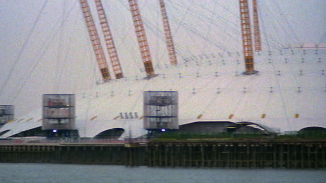 pan millennium dome with thames river in foreground / london, england - the o2 england stock videos & royalty-free footage