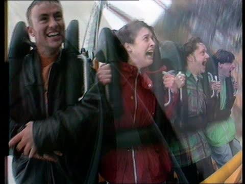 vídeos y material grabado en eventos de stock de millennium exhibition; lib staffs: drayton manor park: track forward as along on rollercoaster ride view of people screaming as along on ride - scream named work