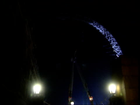 b1300 u'lay england london night gvs millennium wheel fully raised in final upright position - southwest usa stock videos & royalty-free footage