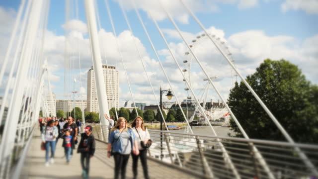 Millennium wheel, people & boats timelapse over Golden Jubilee bridge in London
