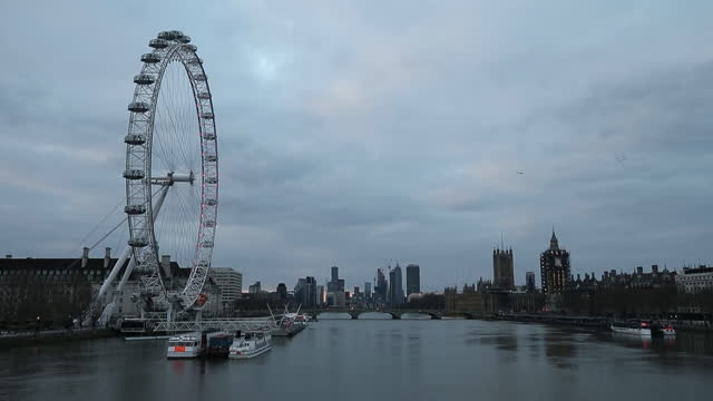 millennium wheel, thames river with london skyline in background. a general view of luxury developments in london. an influx of cash-rich hong kong... - asia stock videos & royalty-free footage