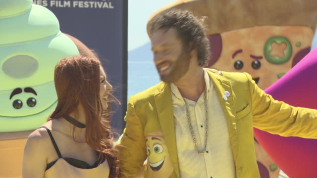 stockvideo's en b-roll-footage met miller, kate gorney at 'the emoji movie' stunt at the 70th cannes film festival on may 17, 2017 in cannes, france. - internationaal filmfestival van cannes