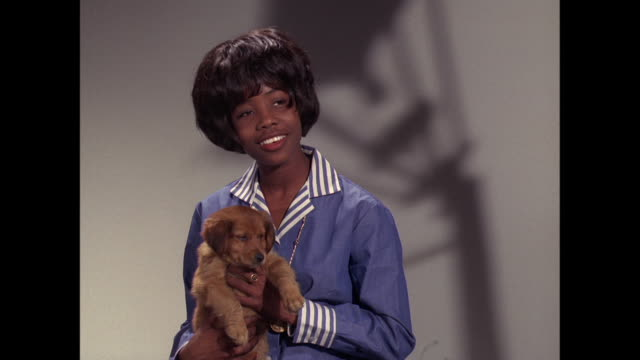 1964 - millie signs 'henry' with a puppy, part 1 - 1964 stock videos and b-roll footage