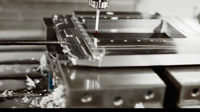 a milling machine uses a ruby red torch probe to measure tolerances of parts in a manufacturing facility - micrometer stock videos & royalty-free footage