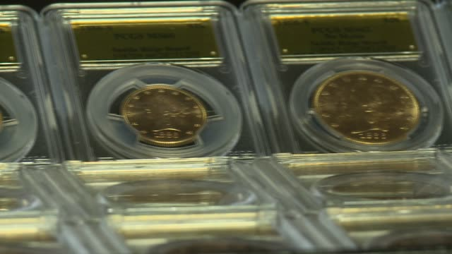 $10 million in gold rush era gold coins found under a tree by a california couple walking their dog pics of the coins and the tins - money press stock videos & royalty-free footage