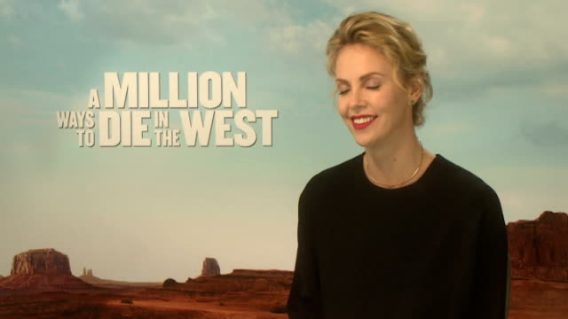 'A Million Ways To Die In The West' film release Interviews ENGLAND London INT Charlize Theron interview SOT what drew her to the role its narrative...