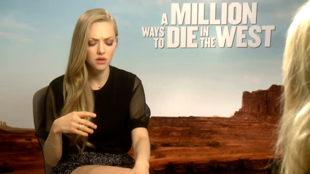 'a million ways to die in the west' film release interviews theron interview sot her favourite line from the film can't say its too disturbing amanda... - religious illustration stock videos and b-roll footage