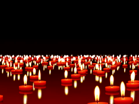 Milioni di candele burning al vento, spazio di copia