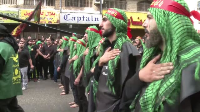 millions of muslims across the shiite world from lebanon to south asia held processions on saturday performing a variety of rituals to mark ashura... - shi'ite islam stock videos & royalty-free footage