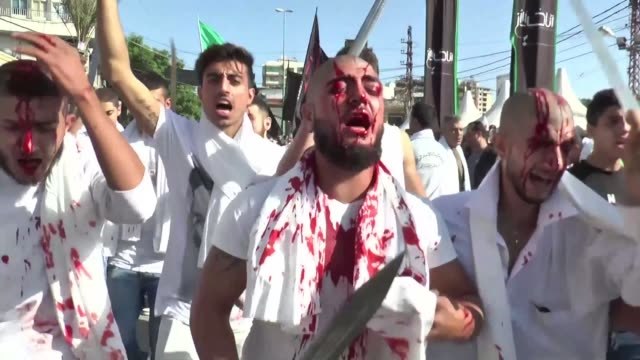 millions of muslims across the shiite world from lebanon to south asia held processions on saturday performing a variety of rituals many involving... - shi'ite islam stock videos & royalty-free footage