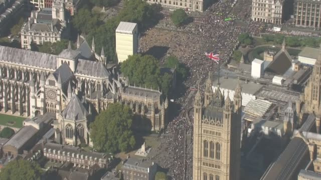 millions of people across the globe join 'largest climate strikes in history'; england: london: westminster: ext air view / aerial climate change... - リチャード・パロット点の映像素材/bロール