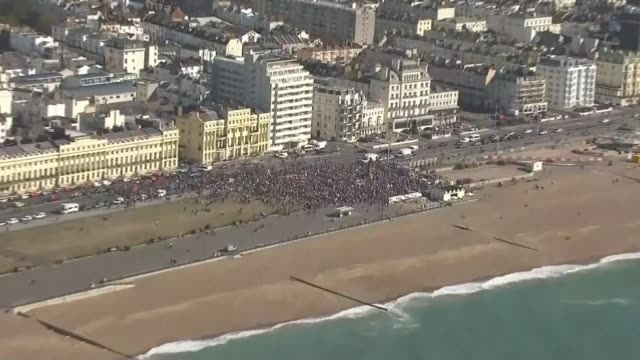 millions of people across the globe join 'largest climate strikes in history' england brighton shots of brighton sea front with protesters along... - beach stock videos & royalty-free footage