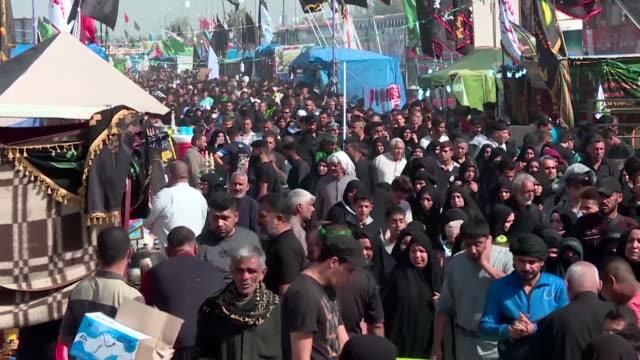 millions of shiite pilgrims travelled to iraq's shrine city of karbala for the arbaeen commemoration thursday of imam hussein's killing in battle - imam hussein stock videos and b-roll footage