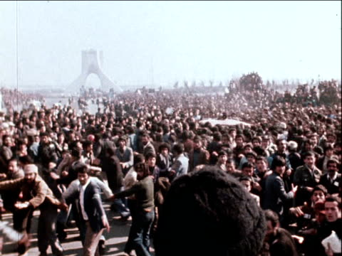 millions of supporters line streets to get glimpse of car carrying ayatollah khomeini following his return to iran after 15 years in exile 1 february... - revolution stock videos & royalty-free footage
