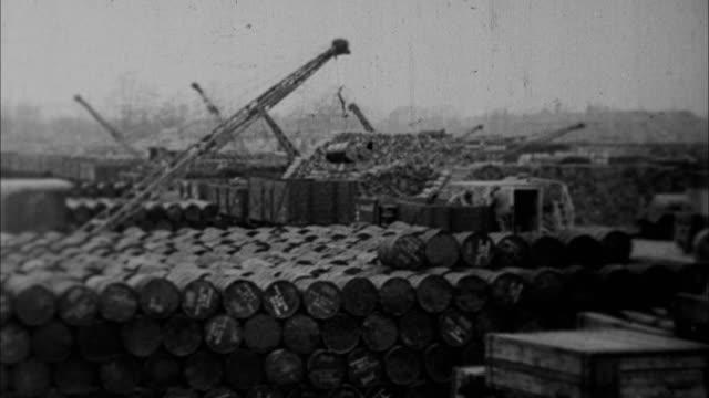 millions of tons of war materials being prepared for world war ii / united states - ドラム容器点の映像素材/bロール
