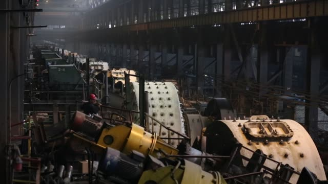 Mills rotate at the dressing plant at the Lebedinsky GOK iron ore mining and processing plant operated by AO Holding Company METALLOINVEST in Gubkin...