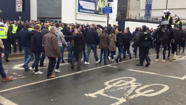Millwall fans head past Spurs fans into the visiting end ahead of the FA Cup quarterfinal