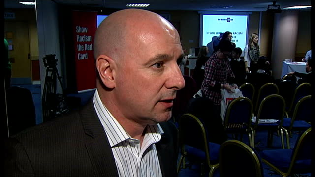 vídeos y material grabado en eventos de stock de millwall host 'show racism the red card' event int andy ambler interview sot cutaways 'show racism the red card' sign on table footballers signing... - autografiar