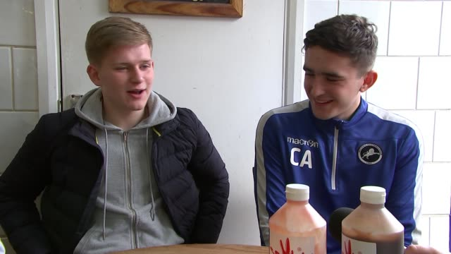stockvideo's en b-roll-footage met millwall prepare for fa cup quarter final match england london south bermondsey int man working behind chip shop counter at the millwall cafe man... - fa cup