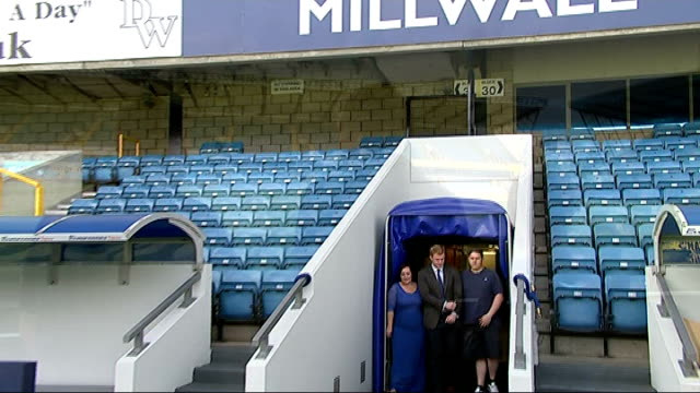 millwall supporter gets married at the den; ext billy wiltshire and sammy wiltshire out of tunnel and onto millwall football pitch with reporter... - tunnel stock videos & royalty-free footage
