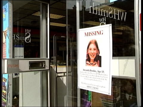 charity gala event lib surrey waltononthames high street pan missing poster for milly dowler on shop window lib police searching undergrowth lib int... - missing poster stock videos & royalty-free footage